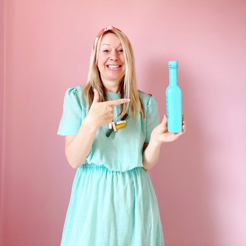 Katya Willems Instagram Expert holding a bottle of special sauce.